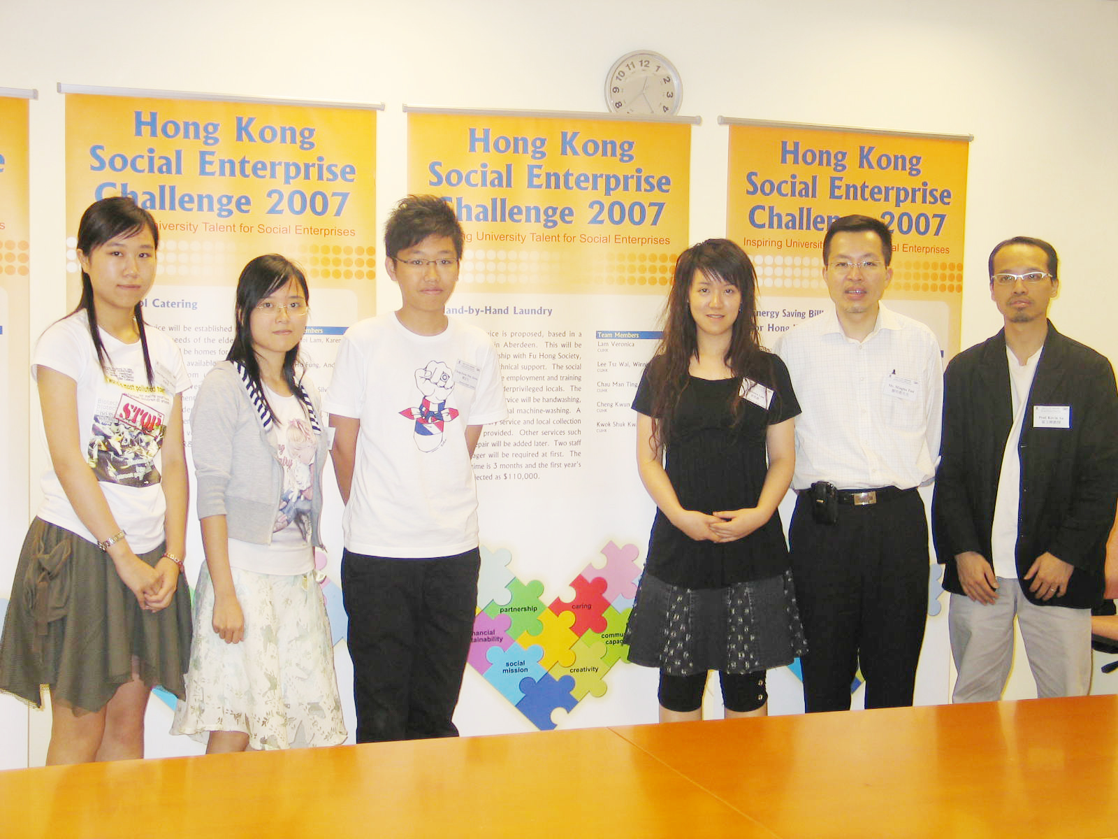 "From left : Mandy Chau, Susan Kwok, Steven Cheng, Veronica Lam, members of ""Hand-by-Hand Laundry"" and Mr. Mingles Tsoi, Project Director, and Prof. Kevin Au, Associate Director from the CUHK's Center for Entrepreneurship."