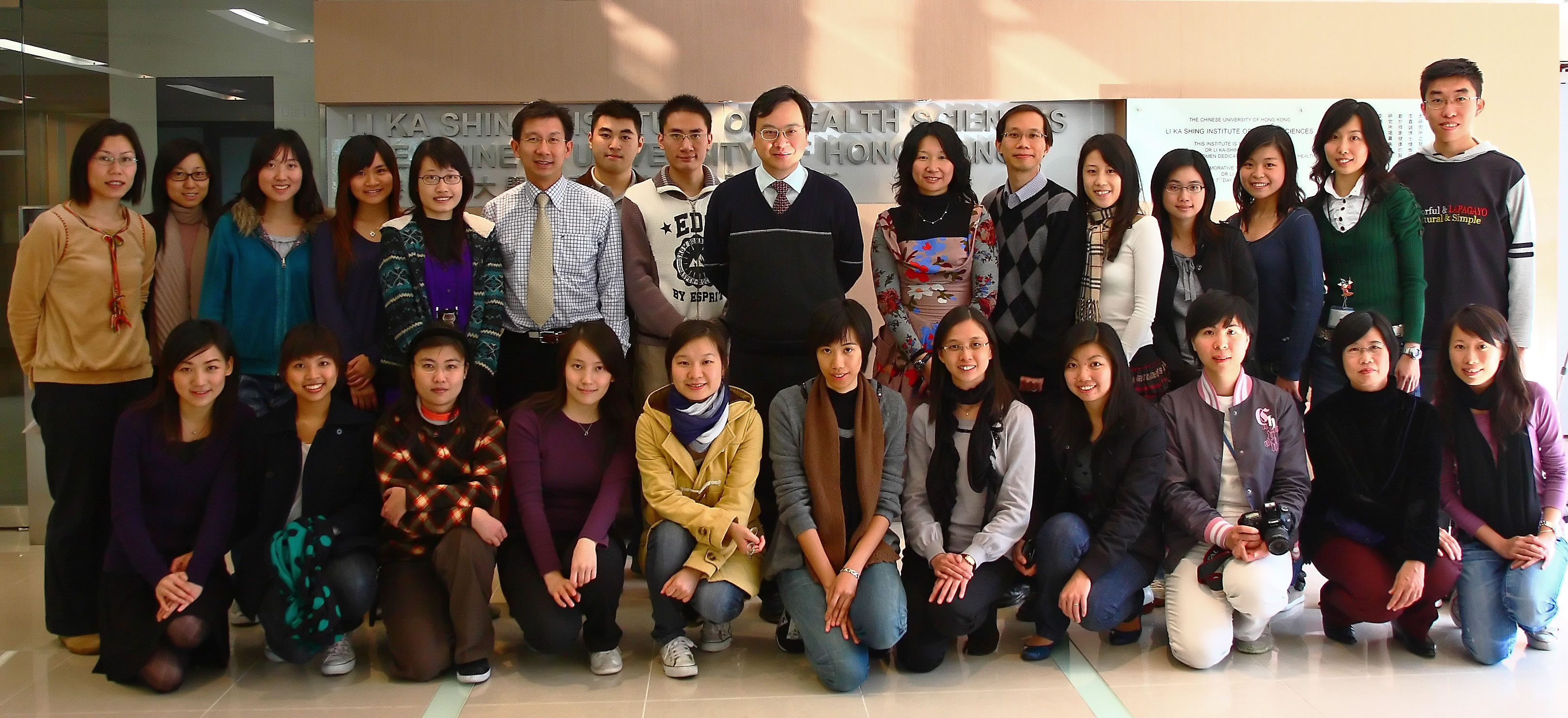 Prof. Dennis Y.M. Lo (centre, back row) with his team of young researchers