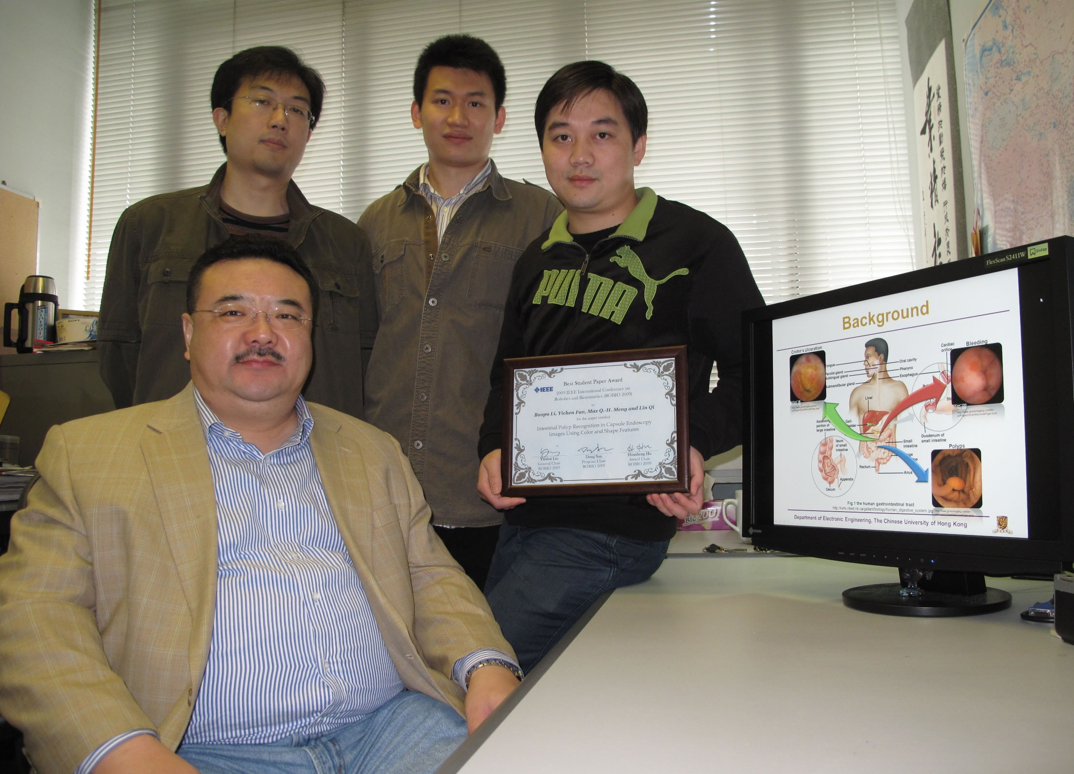 Prof. Max Meng and his PhD students (from left): Lin Qi, Simon Yichen Fan, and Baopu Li