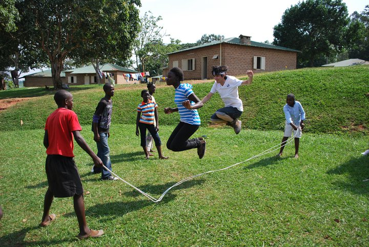 The students visit many children's villages and play games with them.