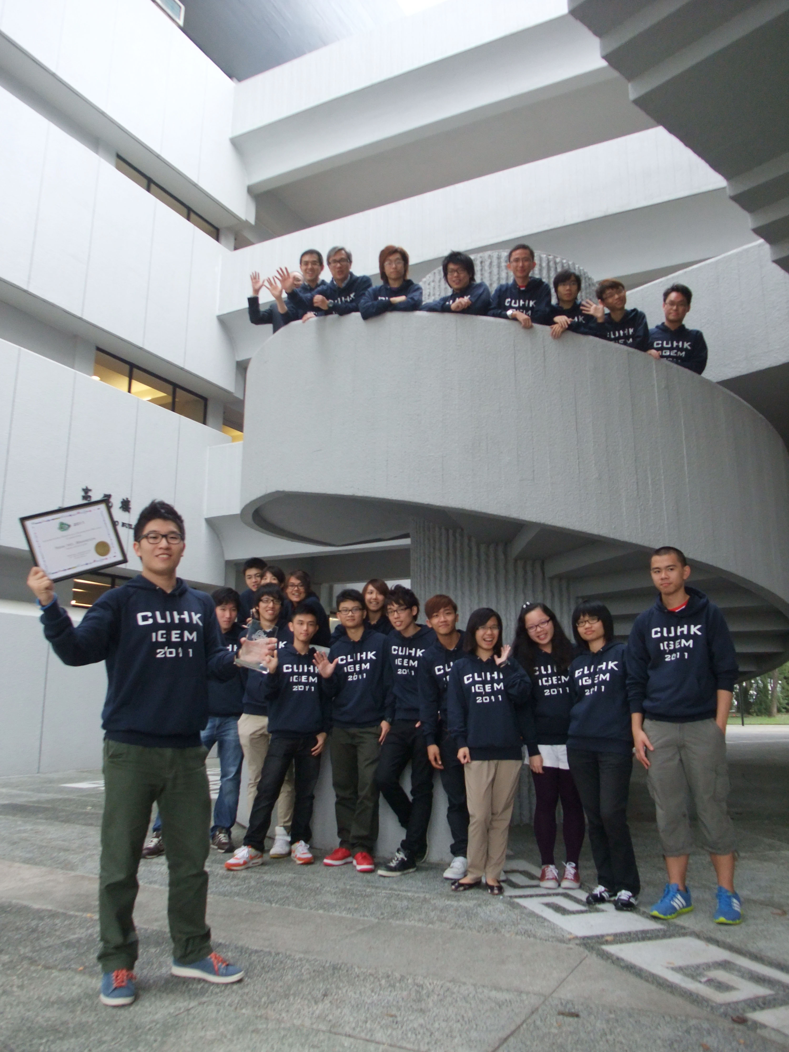 A group photo of the winning students and their coaches