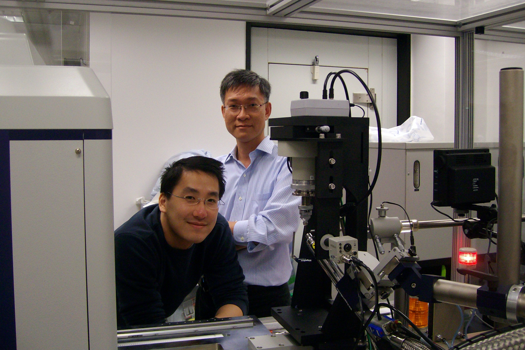 Prof. Wong Kam Bo (right) and his graduate student, Ivan Fong, with the X-ray diffractometer.