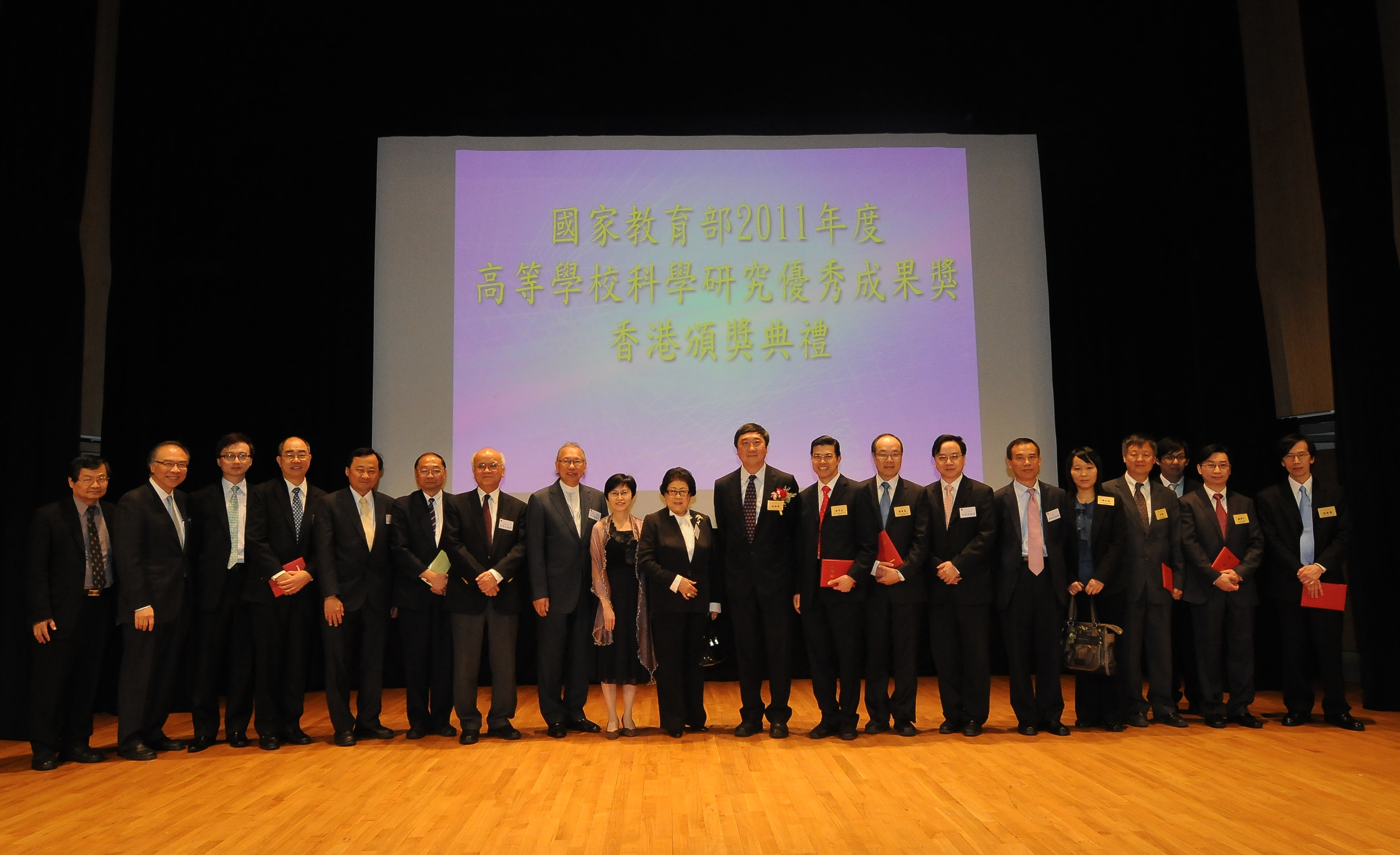 A group photo of CUHK award recipients with their guests and colleagues.