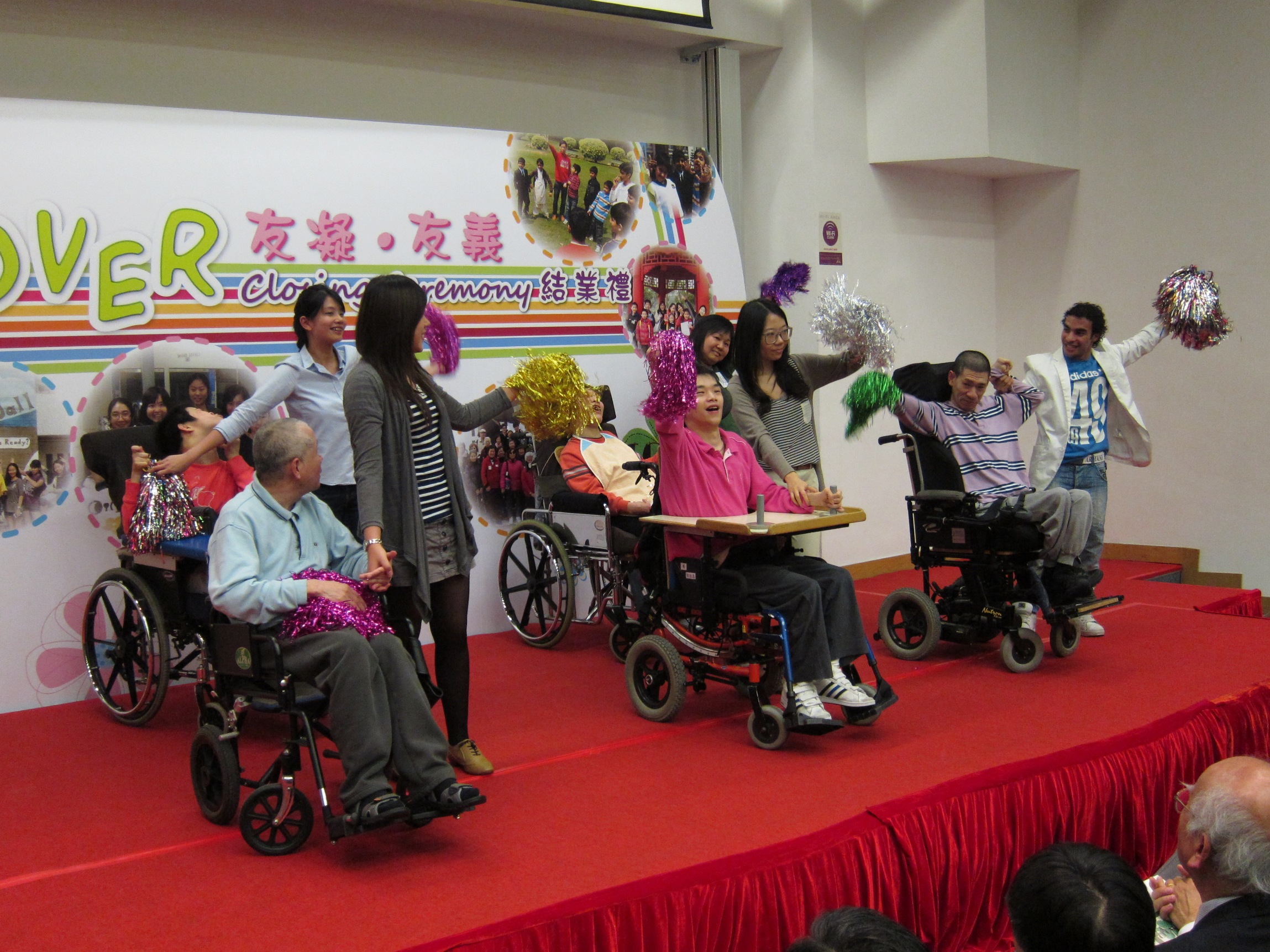 Some developmentally disabled service clients perform wheelchair dance along with CUHK students during the ceremony.