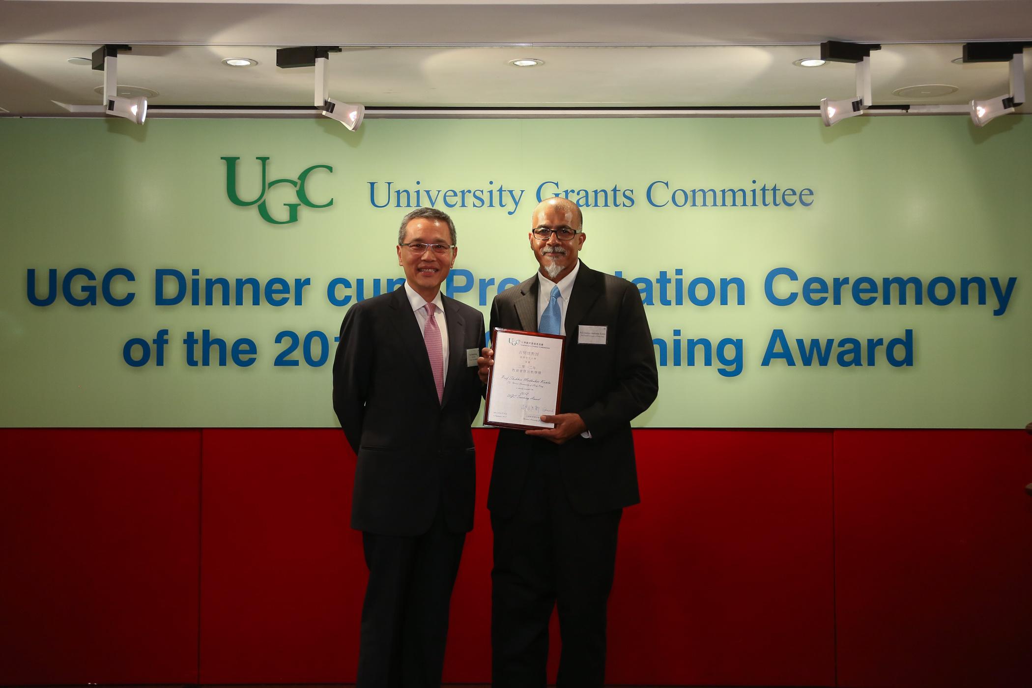Mr. Edward Cheng, UGC Chairman presents the award to Professor Kumta