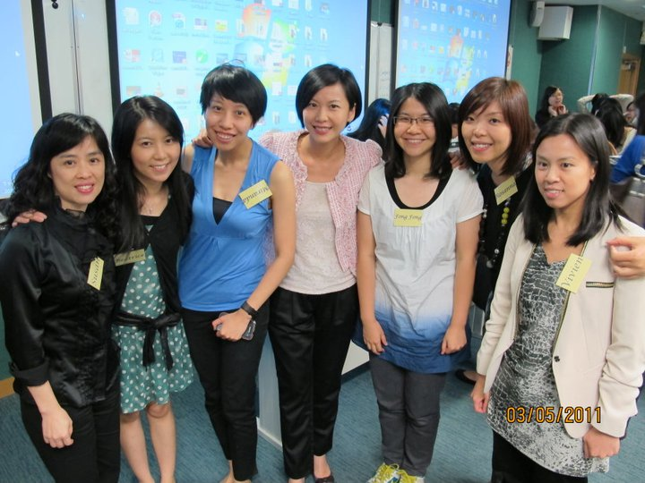 Prof. Kaman Lee with students in class.