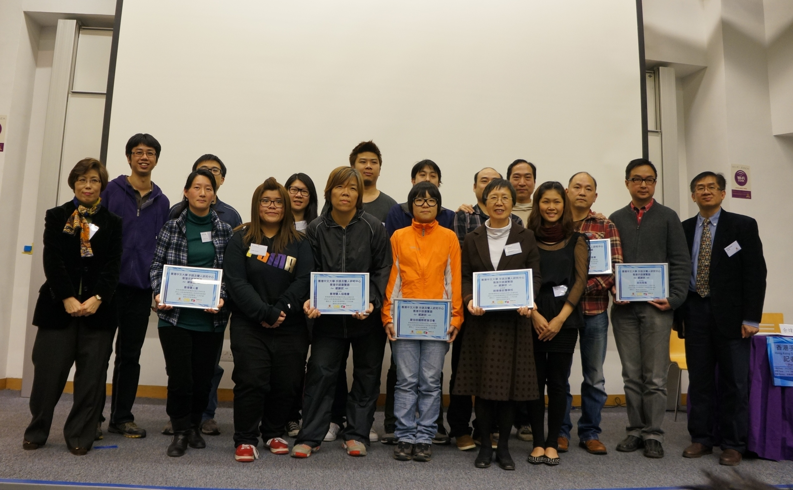 A group photo of presenters with the representatives of the deaf associations