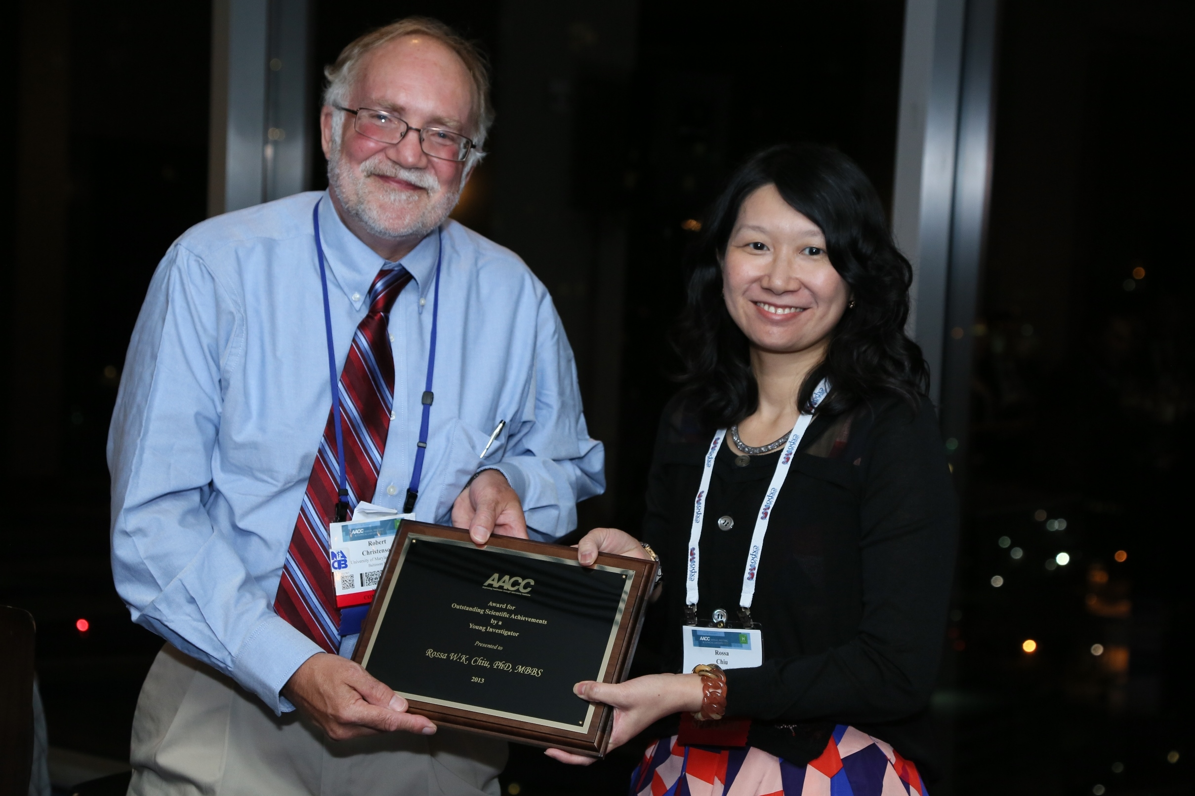 Dr. Robert Christenson, President of AACC, presents the award plaque to Prof. Rossa Chiu.