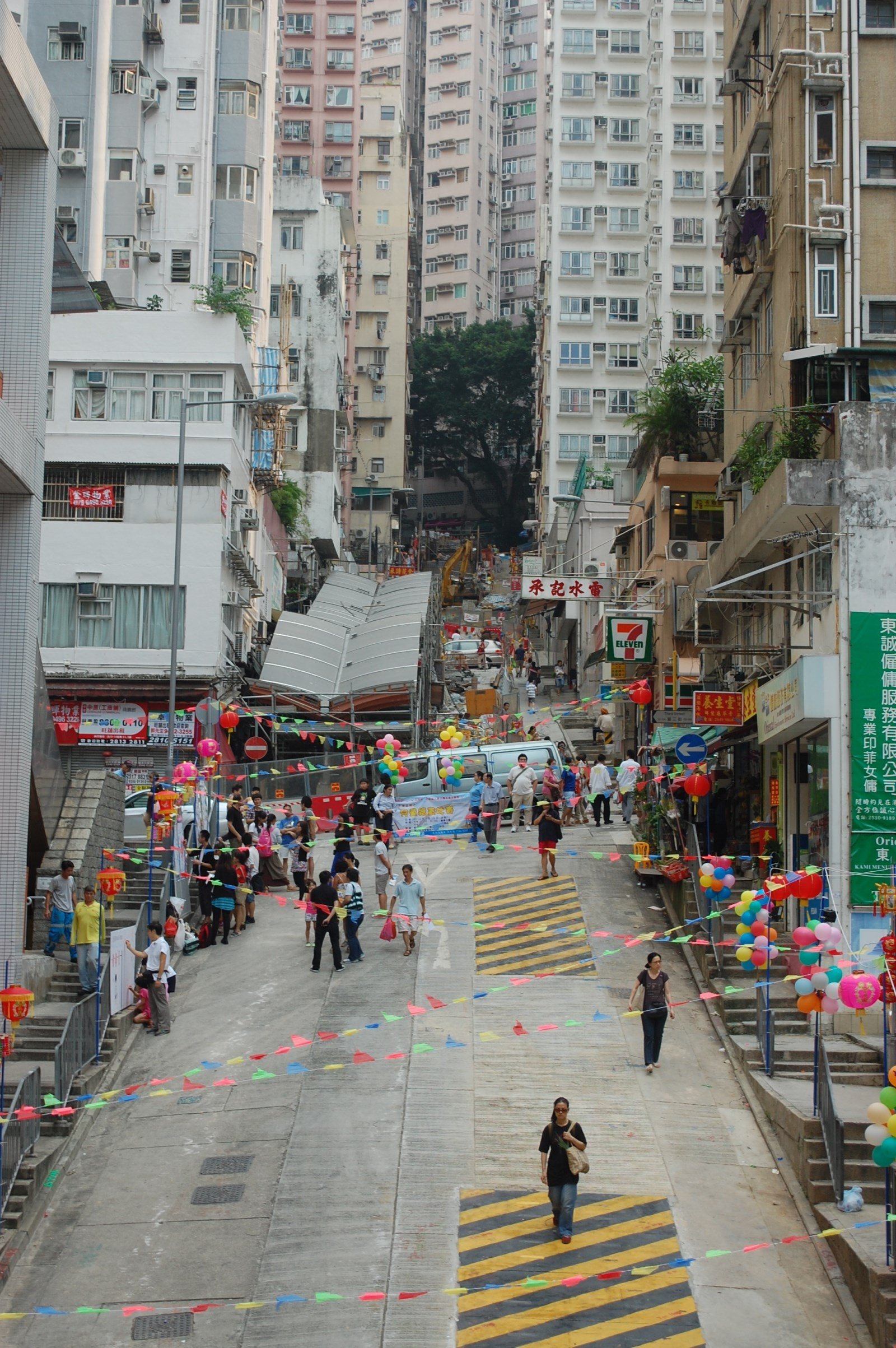 """The """"Magic Carpet"""" outdoor cinema will be held at the steeply sloped Centre Street, which has become an underused public space. Encircled by Sai Ying Pun's unique cityscape and eclectic architectural styles, one also catches a glimpse of Victoria Harbour on Centre Street."""