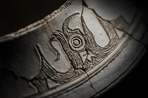 Phoenix motif on white pottery vessel from approximately 7,000 years ago, unearthed at Qianjiaping site, Guiyang County, Hunan, China.