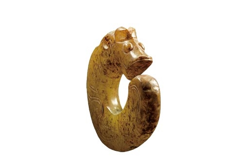Shang dynasty jade dragon with protruding eyes from Fu Hao tomb, Henan, China.