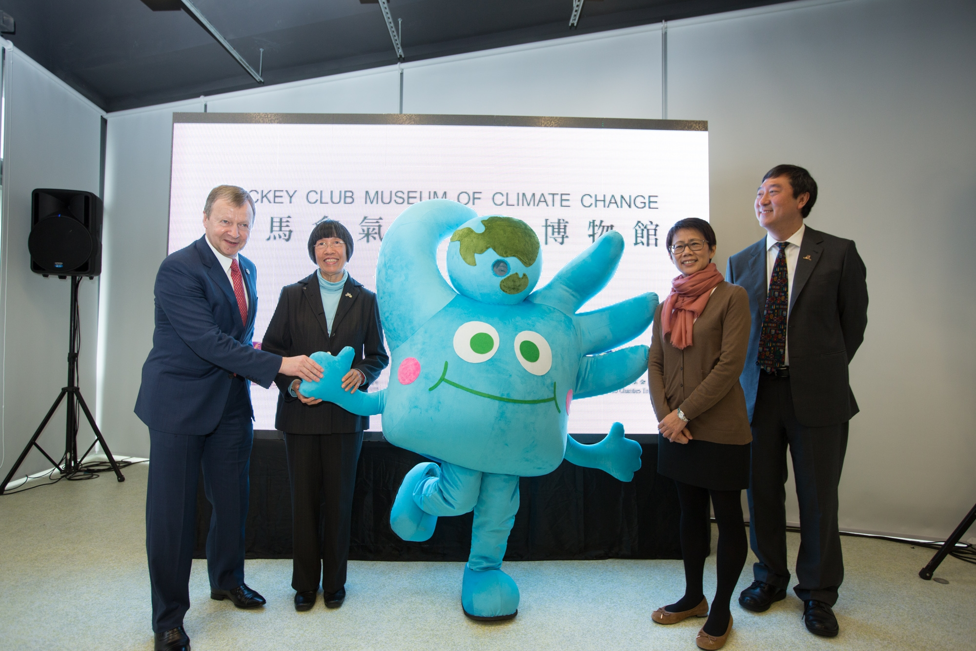 (From left) Mr Winfried ENGELBRECHT-BRESGES, Dr Rebecca LEE, Ms Christine LOH and Prof Joseph J Y SUNG take a photo with 'Little Gaia', the mascot of CUHK Jockey Club Initiative Gaia.