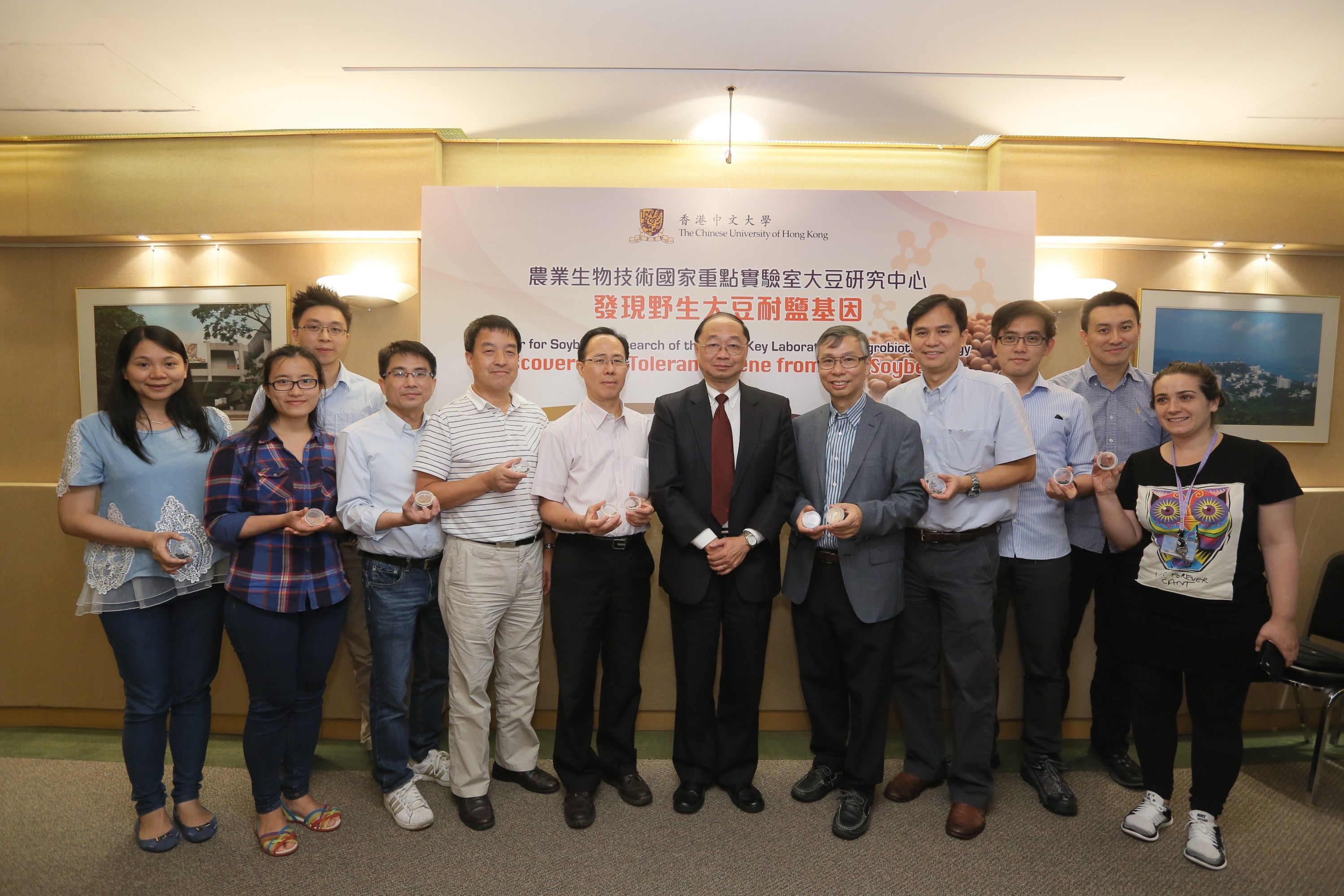 Prof Henry Wong, Dean of Faculty of Science (middle), Professor Lam (5th right) and his team members at the Center for Soybean Research, CUHK.