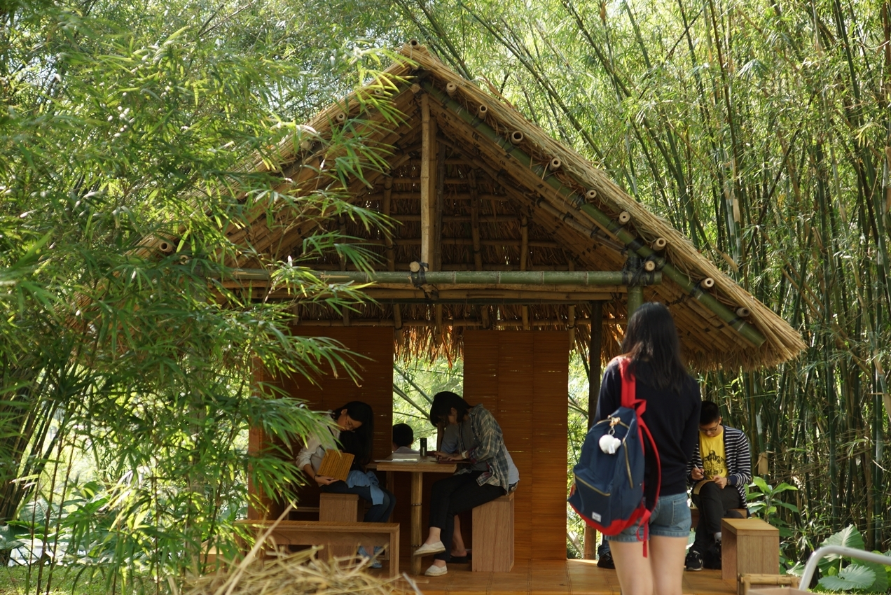 Bamboo scrolls are provided at the thatched cottage for people to write down their thoughts.