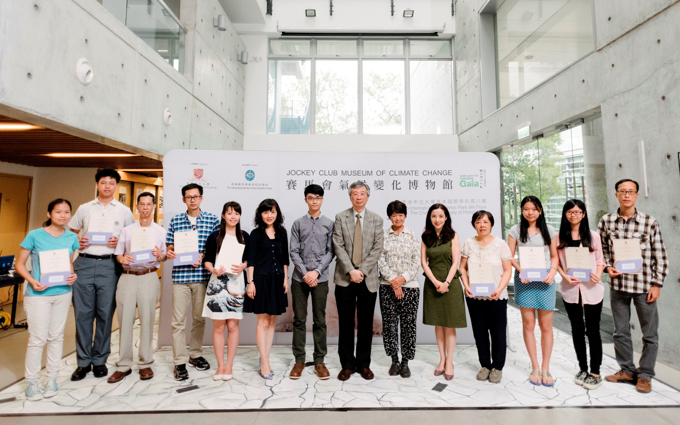 (6th–10th left) Mrs Cecilia LAM, Programme Director of CUHK Jockey Club Initiative Gaia; Mr Harry SIT, President of CUHK Chung Chi Photography Society; Prof. FUNG Tung, Associate Vice-President of CUHK; Ms CHOW Chung Ling, Honorary Advisor of the Chinese YMCA Photography Society HK, and Ms Shirley FISHER, Charities Manager of The Hong Kong Jockey Club post for a group photo with winners of the Eco Tour Photo Contest.