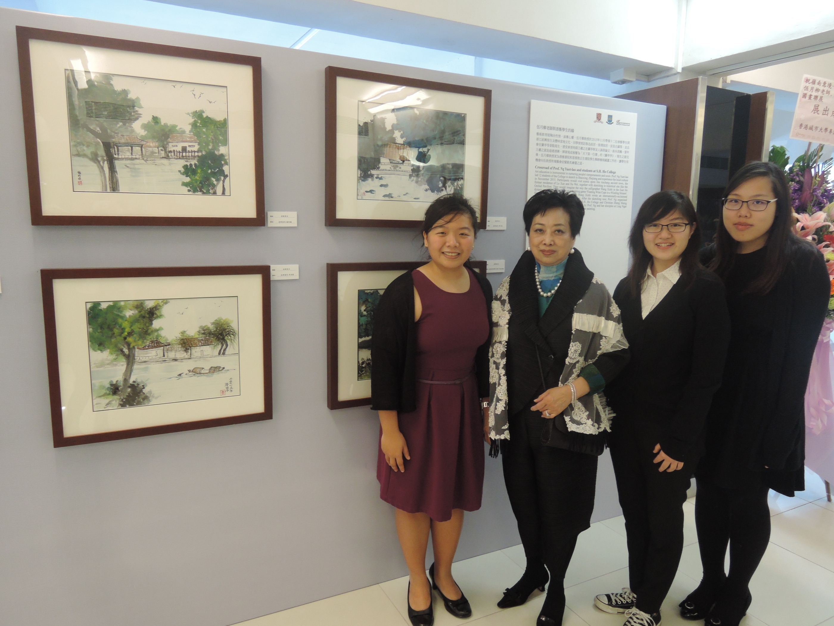 Prof Ng Yuet-lau led a group of College students to sketch at the historical Chinese city of Shaoxing to enhance students' aesthetic sense and painting skills. This photo is taken in front of the students' paintings.