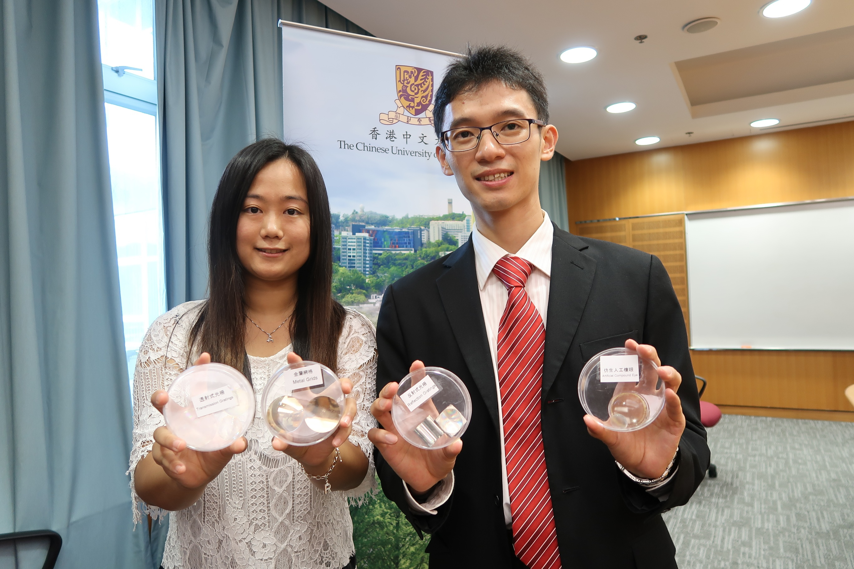 The project winning Grand Prize for innovation and also the First-Class Award of Mechanical and Control System is a vacuum nanoimprinting system developed by CHEN Jianwei, a PhD student from the Multiscale Precision Instrumentation Laboratory of the Department of Mechanical and Automation Engineering, CUHK (right).