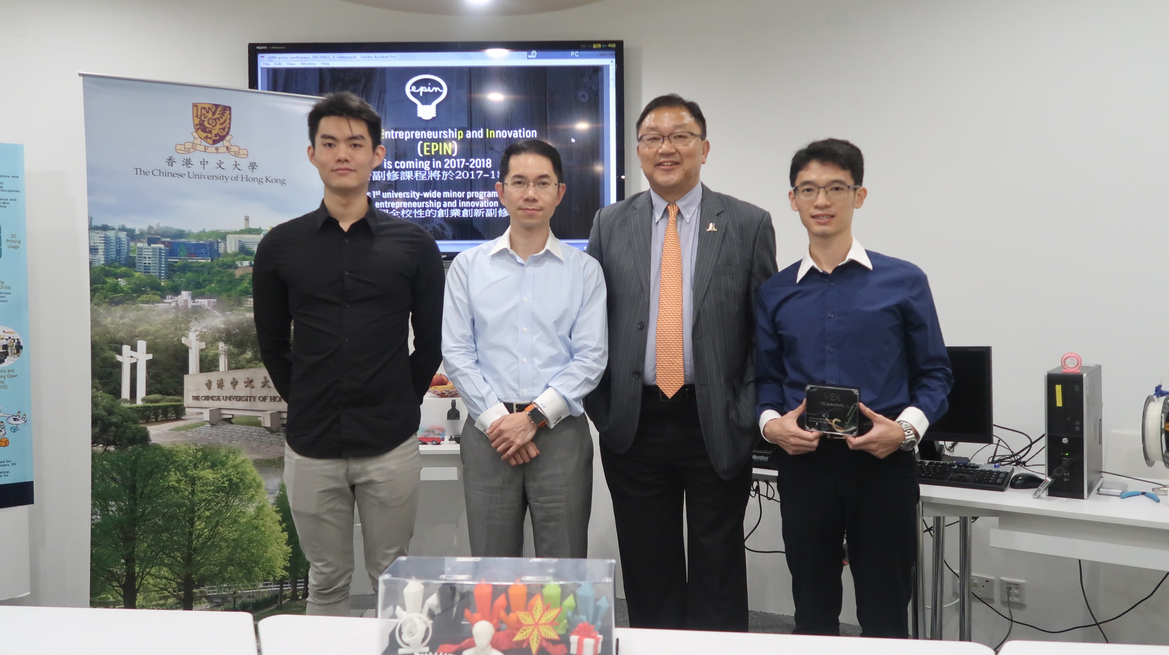 (From left) Mr. James Chen, Year 2 student, Quantitative Finance Programme; Dr. Andy Wong,  Assistant Dean of the Faculty of Business Administration and Prof. Kam-fai Wong, Associate Dean of the Faculty of Engineering, both are Co-directors of the EPIN Minor Programme; and Dr. Jianwei Chen, Research Associate, Department of Mechanical and Automation Engineering, CUHK.
