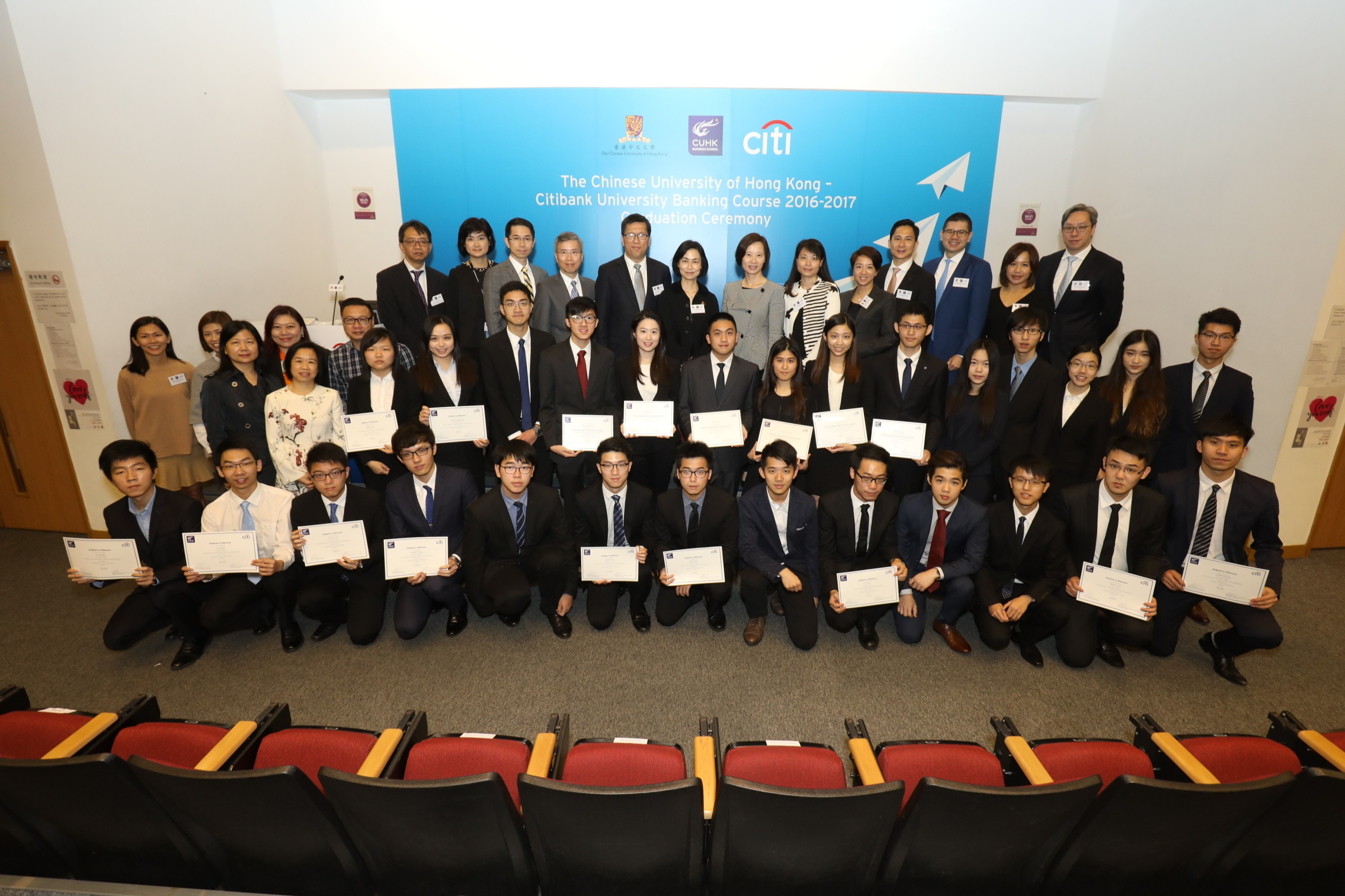 Students from the CUHK Business School are presented with their certificates for completing the three-month program