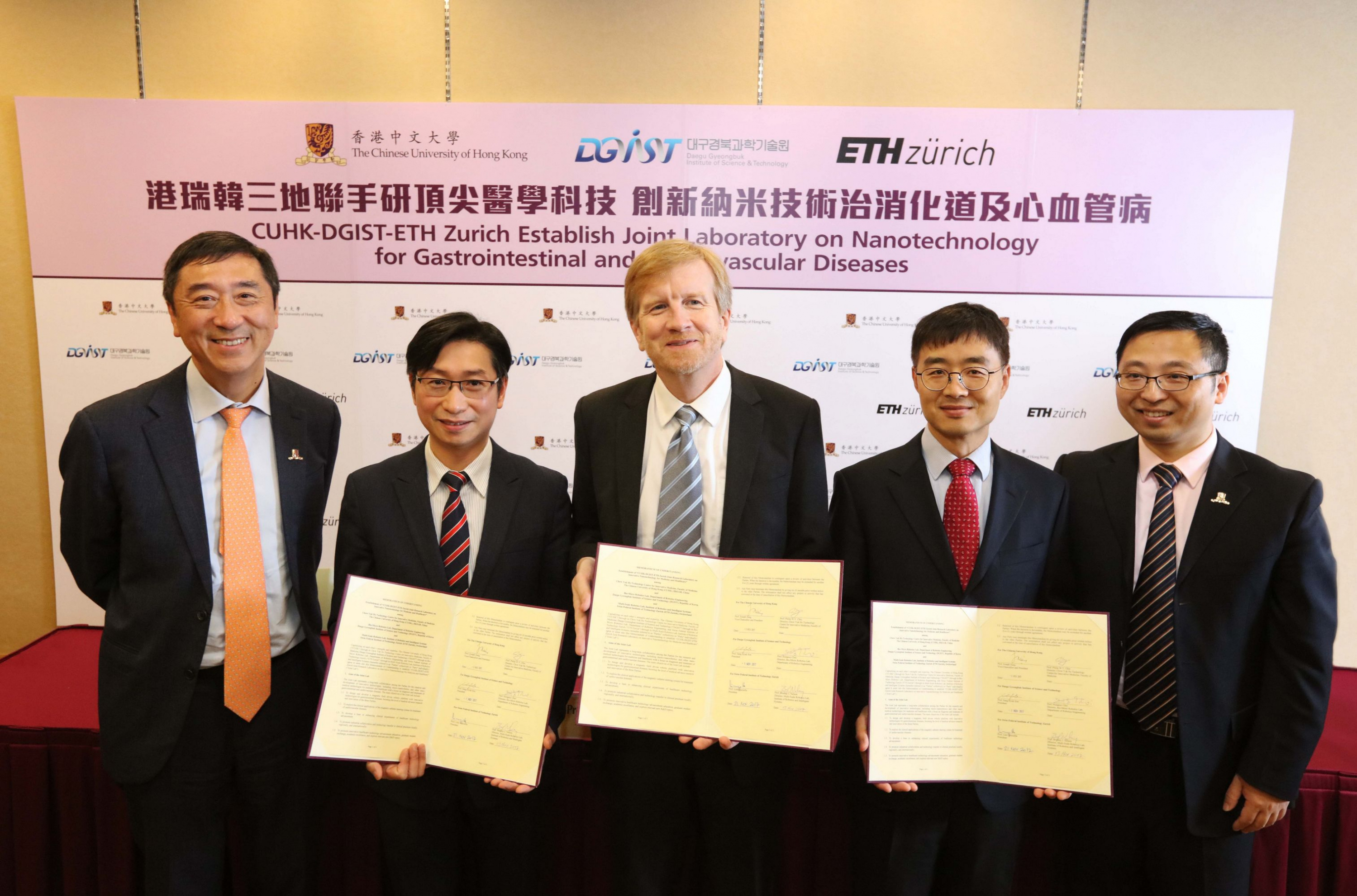 (From left) Prof. Joseph SUNG, Vice-Chancellor and President of CUHK; Prof. Philip CHIU, Director of the Chow Yuk Ho Technology Centre for Innovative Medicine, CUHK; Prof. Dr. Bradley NELSON, Director of the Multi-Scale Robotics Lab, Institute of Robotics and Intelligent Systems, ETH Zurich; Prof. Hongsoo CHOI, Director of the Bio-Micro Robotics Lab, Department of Robotic Engineering, DGIST and Prof. Li ZHANG, Associate Professor, Department of Mechanical and Automation Engineering, CUHK, take a group photo after signing the MOU to establish a Joint Research Laboratory on Innovative Nanotechnologies for Medicine and Healthcare