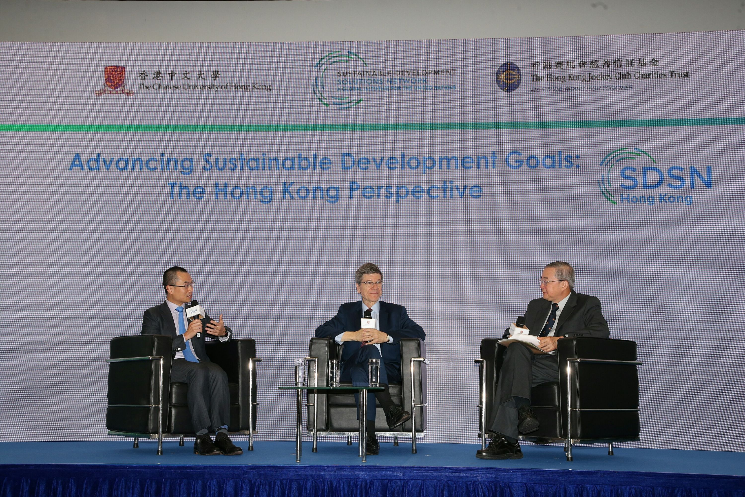 Director of the UN SDSN Professor Jeffrey Sachs (centre); Executive Director, Charities and Community of The Hong Kong Jockey Club Mr Leong Cheung (left), and Director of the Institute of Environment, Energy and Sustainability and AXA Professor of Geography and Resource Management of CUHK Professor Gabriel Lau (right) at the panel discussion on 'Advancing Sustainable Development Goals: The Hong Kong Perspective'.