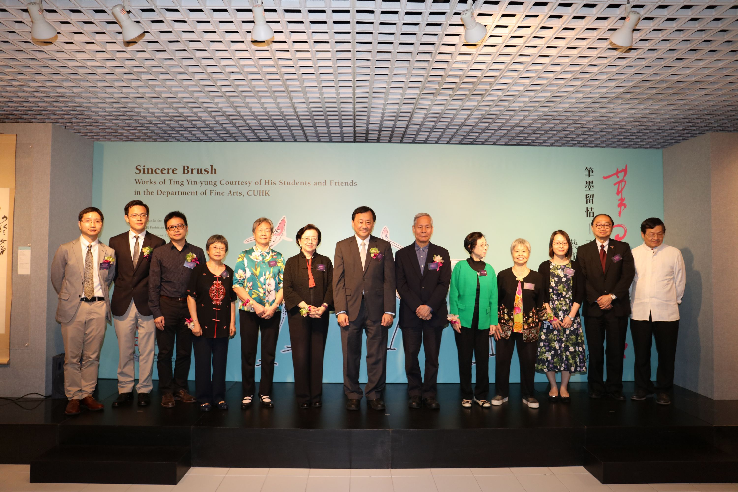 (From left) Dr. Phil Chan, Research-Assistant Curator (Painting and Calligraphy) of the Art Museum, CUHK; Professor Josh Yiu, Director of the Art Museum, CUHK; Mr. Lo Kwan Chi, Chairman of The Alumni Association of Fine Arts Department, CUHK; Ting Lai Ting; Ting Lan Sai; Professor Mayching Kao, former Professor of Fine Arts and former Director of the Art Museum, CUHK; Professor Benjamin W. Wah, Provost, CUHK; Professor Lee Yun-woon, former Chairman of the Department of Fine Arts, CUHK; Ting Lo Sai; Ting Lai Kar; Professor Wan Chui Ki, Acting Chairman of the Department of Fine Arts, CUHK; Professor Henry N.C. Wong, Head of New Asia College, CUHK; Professor Leung Yuen-sang, Director of the Institute of Chinese Studies, CUHK officiate at the ribbon-cutting ceremony for the exhibition.
