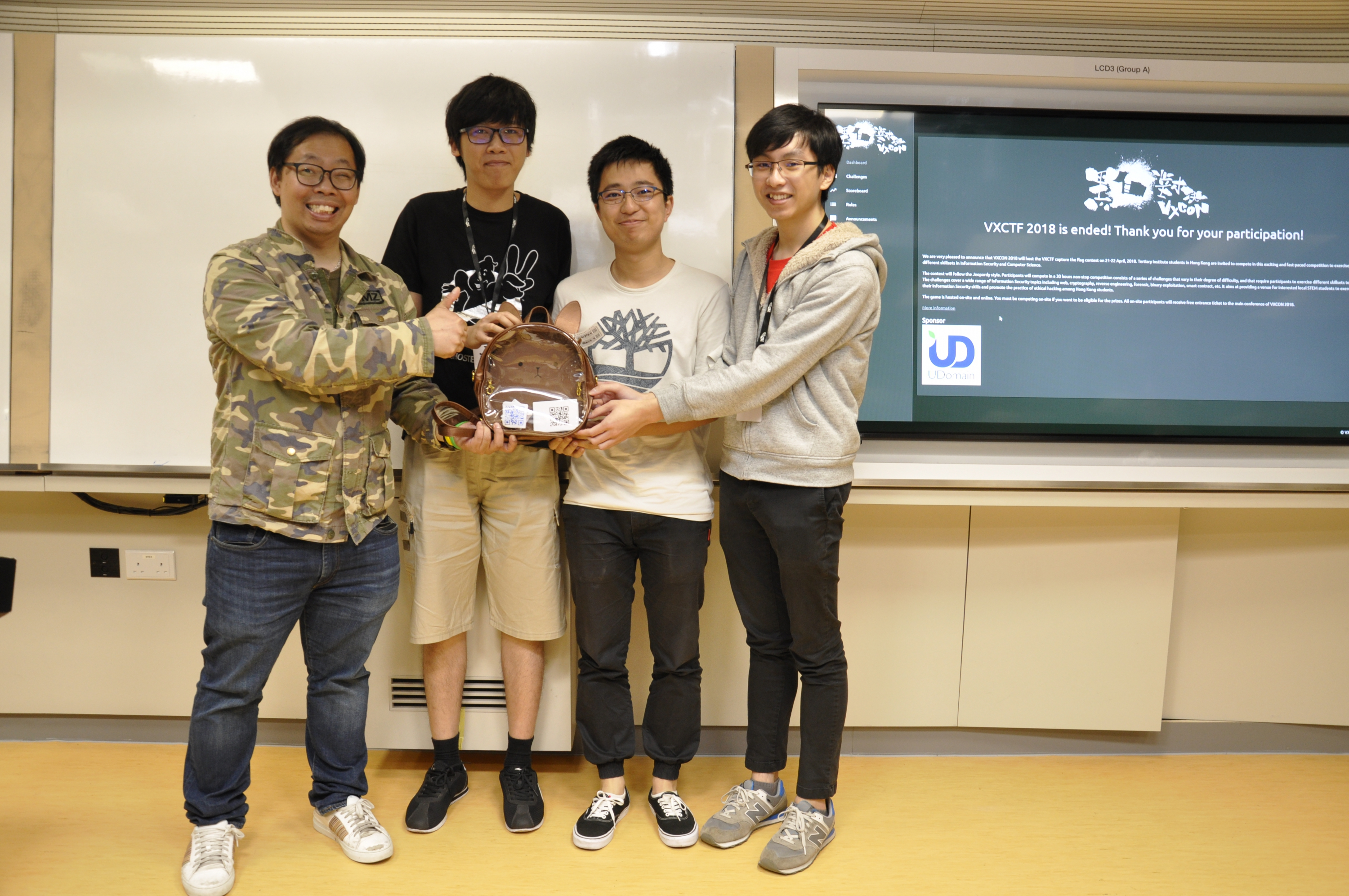 (From 2nd left) Cham Fei TONG from the Department of Computer Science and Engineering, Yihui ZENG from the Department of Mathematics, and Shing Yuet LEUNG from the Department of Information Engineering beat the other ten teams from four tertiary institutions to win the championship in the VXCTF 2018.
