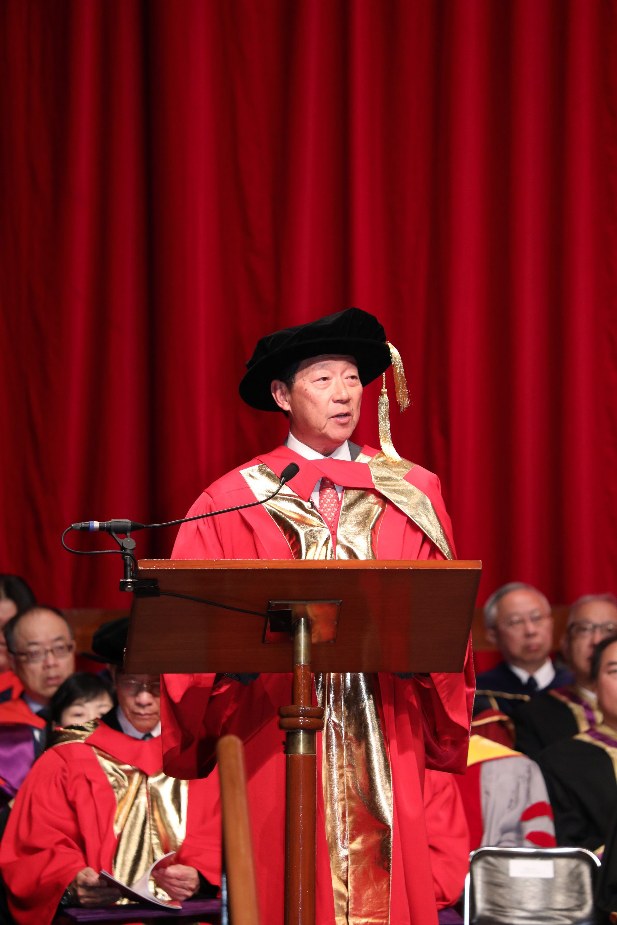 Dr. Ip Sik-on Simon delivers a speech