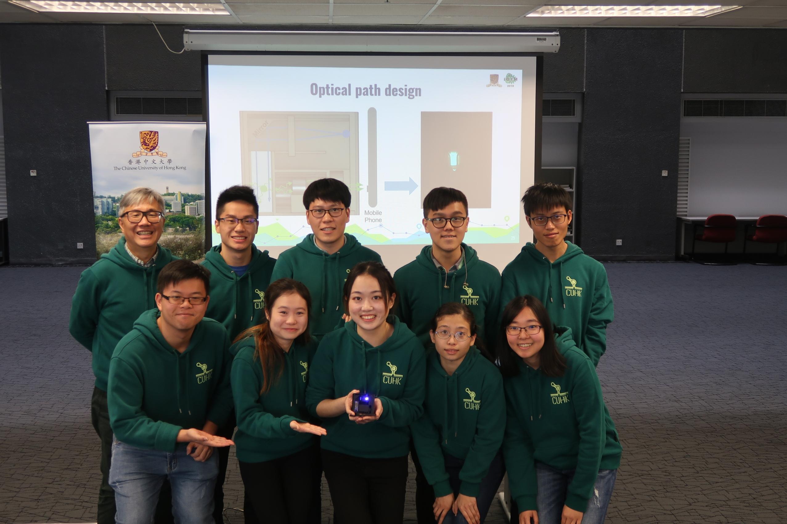 Professor Chan King-ming, associate professor of the School of Life Sciences, CUHK (1st left, back row) and the CUHK iGEM team.