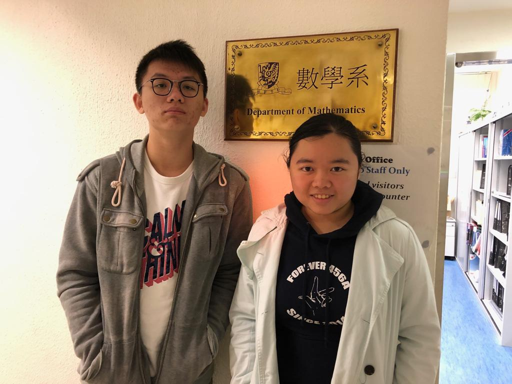 1st place winners of the Pairs prize Mandy Kwok (right) and Samuel Lee.