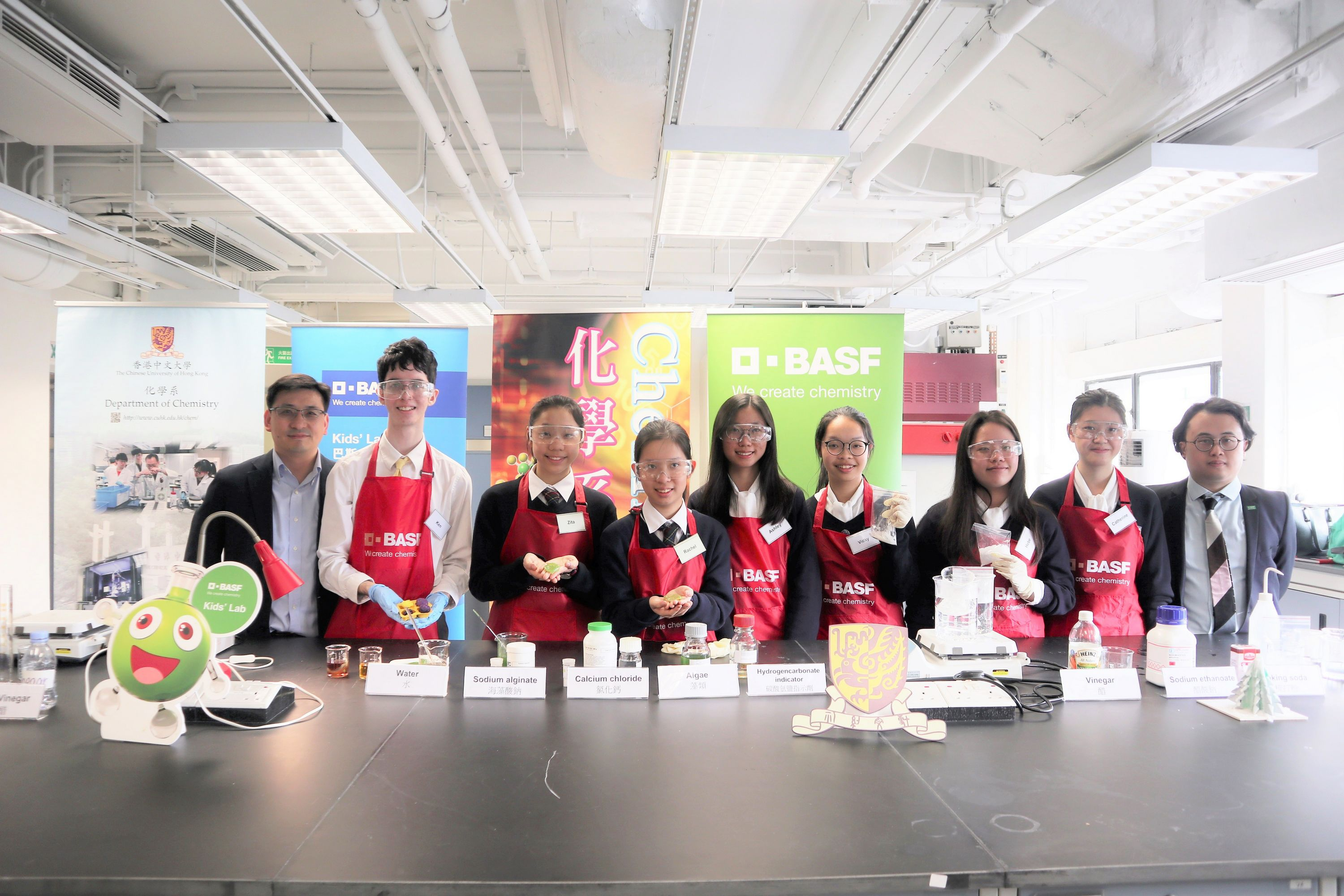 A group photo of the three winning teams along with Prof To Ngai (left), Department of Chemistry, CUHK and Jeremy Tam (right), Manager, Corporate Communications Asia Pacific, BASF.
