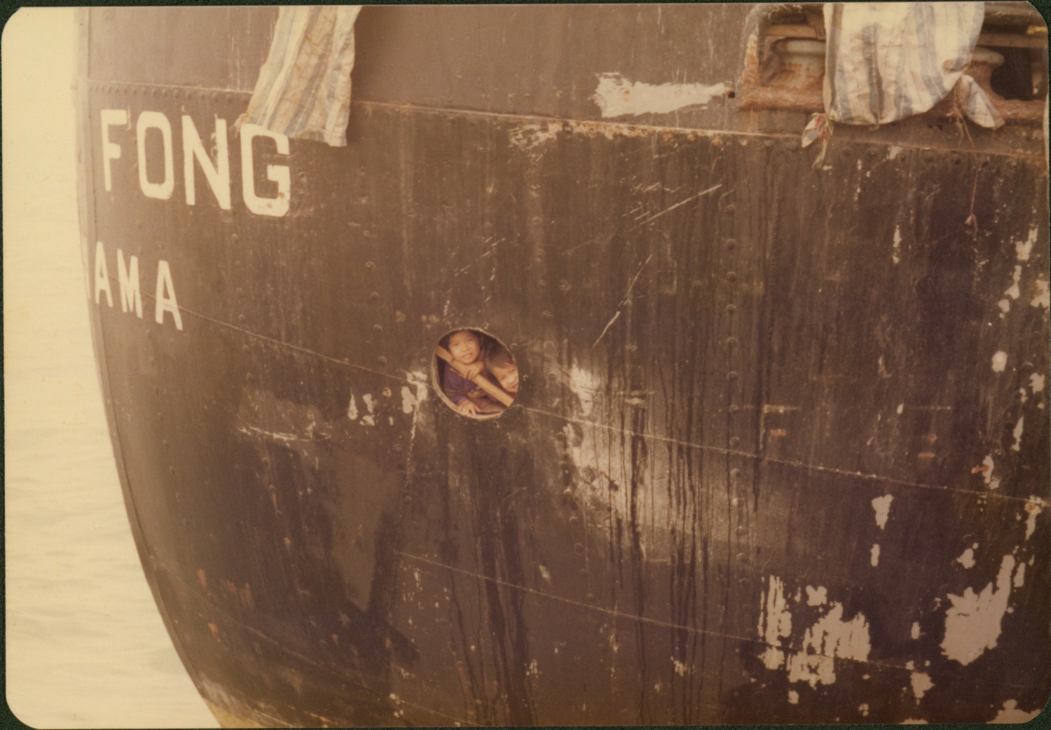 Les Bird, a former member of Marine Police in Hong Kong, will display his private photo collection for the first time in this exhibition. This photo was taken in 1978. Nearly 3,000 Vietnamese refugees arrived in Hong Kong on HUEY FONG. Two little girls peek out from the small porthole.