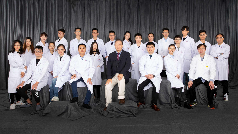 Professor Ling Qin and his research team members