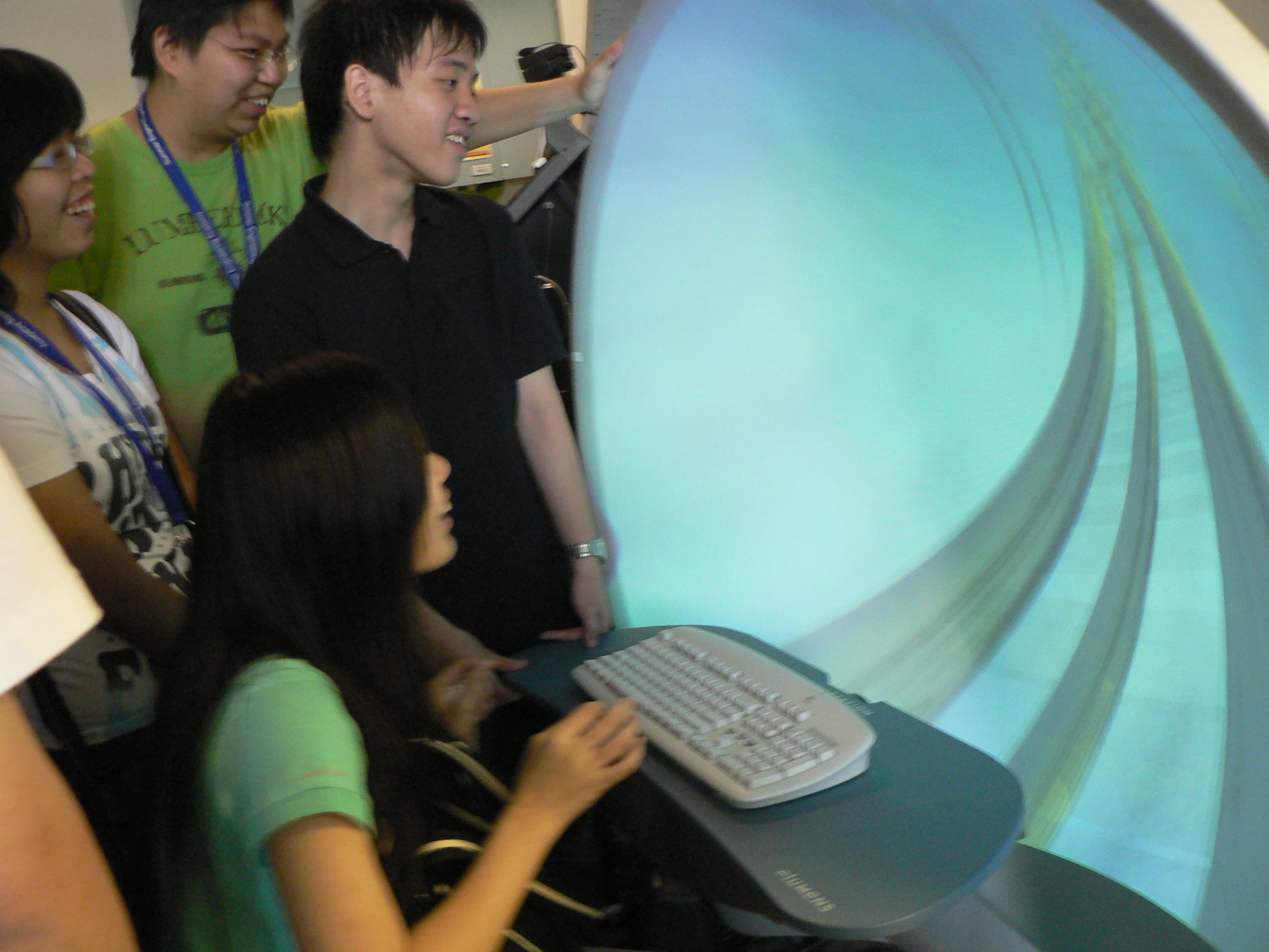 Students experience a virtual roller coaster game using tele-immersion technology at the Virtual Reality Visualization and Imaging Research Centre of CUHK