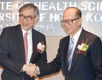 Professor Lawrence J. Lau, Vice-Chancellor of CUHK, and Dr Li Ka-shing congratulate each other at the unveiling ceremony of Li Ka Shing Institute of Health Sciences.