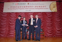 CUHK Vice-Chanellor Professor Lawrence J. Lau (far right) and SHKP Executive Director Mr. Thomas Chan (far left) presenting souvenirs to two Nobel Laureates addressing at the lecture.