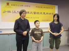 Mrs. Tsang (right) and her son demonstrating Dan Tian breathing with Prof. Agnes Chan