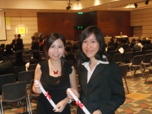 Cindy Chan (left), who interned at L'Oreal, Paris last year and Bonnie Chan, who interned at ETO, Berlin this year, receive their internship certificate