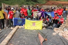 Students of S.H. Ho College work with local workers in Uganda to build a student dormitory with their bare hands.