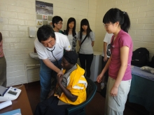 Prof. Joseph J.Y. Sung leads the medical students to do physical check-up and make diagnosis for the locals.
