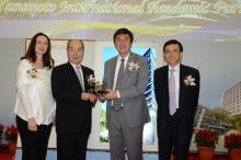 Prof. Joseph Sung presents a CUHK 50th anniversary souvenir to Dr. & Mrs. Alex Yasumoto.