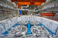 Four antineutrino detectors submerged in pure water in the Daya Bay Far Hall, each being 5m in height and diameter, all in place in September 2012. The Hong Kong team designed and built a subsystem in each of the detectors.