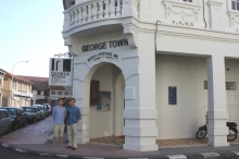 XU Kuo, Richard (left) posed at the gate of the George Town World Heritage Incorporated office.