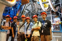 Part of the CUHK team in front of the ATLAS detector. From right to left: Prof. Chu Ming-chung, Research Assistant Chan Yat Long, MPhil student Tsui Ka Ming, undergraduate students Chow Yun Sang, Tam Pok Ho, Dung On Yu, and PhD student Lu Haonan.