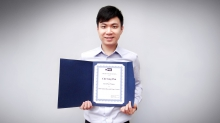 """Pun Chi-seng shows his award certificate for his research paper """"Combined Estimation-Optimization (CEO) Approach for High Dimensional Portfolio Selection""""."""