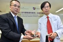 Professor Yu (right) and Professor Ng showcase the microspheres and catheter using in PAE.