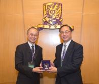Prof. Tai-fai Fok, CUHK Pro-Vice-Chancellor (left) presents a souvenir to Mr. Nicholas W. Yang, Secretary for Innovation and Technology.