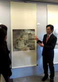 Prof. Philip Chiu introduces his painting named 'Medical Hero'.