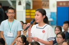 A member of the audience shares her views at the question and answer session.