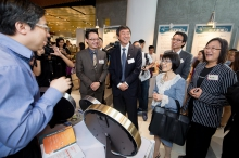 Prof. Joseph Sung and guests visit the exhibition booths.